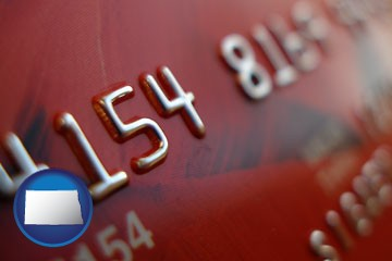 a credit card macro photo - with North Dakota icon