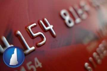 a credit card macro photo - with New Hampshire icon