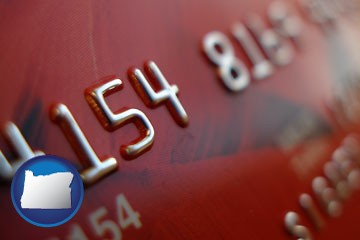 a credit card macro photo - with Oregon icon