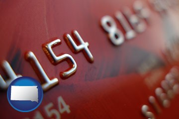 a credit card macro photo - with South Dakota icon